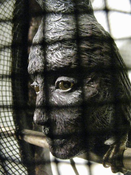 """""""Behind Your Eyes"""" (detail), 2014, vintage fencing mask, earphones, Sculpey, acrylic paints, glass eyes, mixed media, 34"""" x 18.5"""" x  6.5"""""""
